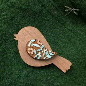 bird brooch coat