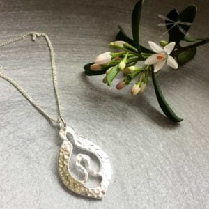 Nurture sterling silver pendant