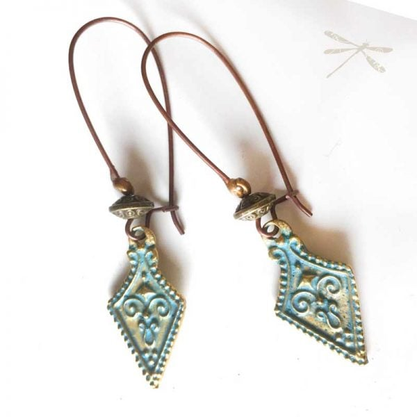 patina drop spear shoe earrings