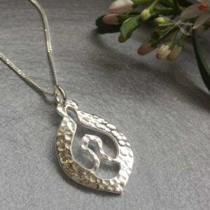 Nurture stering silver pendant