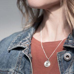 lady wearing journey pendant