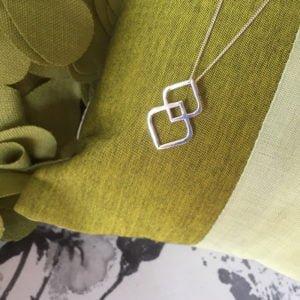 silver unity pendant